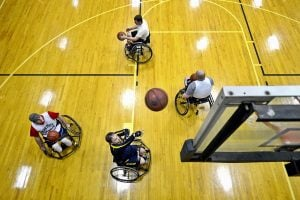 Four men playing wheelchair basketball
