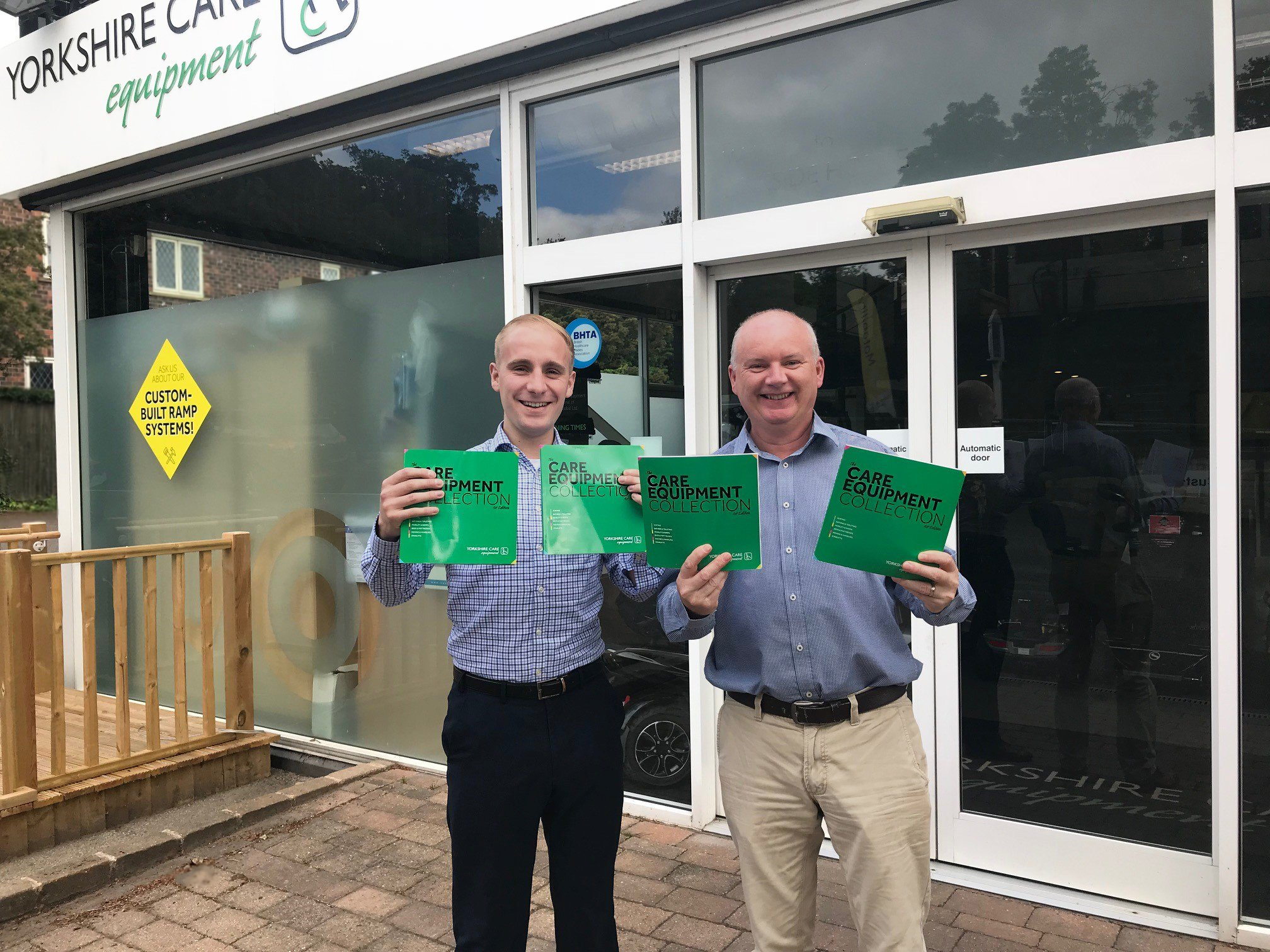 David Jordan and Gary Hornsby-Shawe holding the Care Equipment Collection brochure.