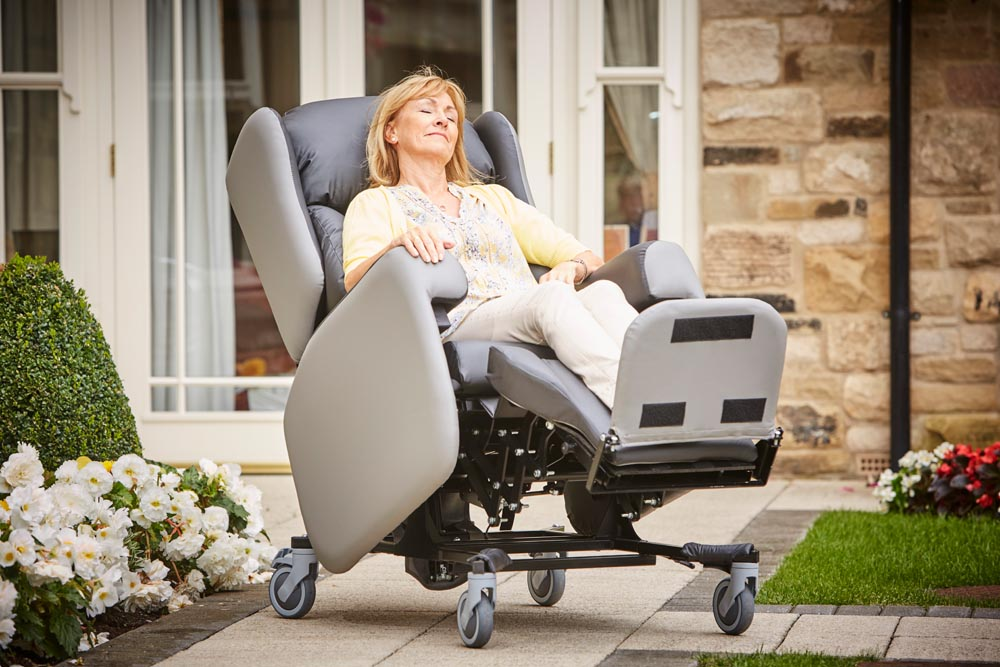 The Lento care chair tilted back to redistribute body weight over a bigger surface area