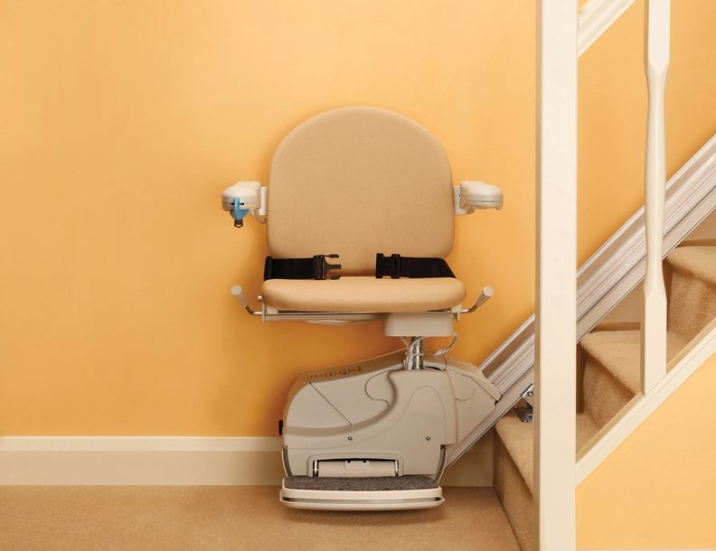 A straight stairlift sat at the bottom of a staircase