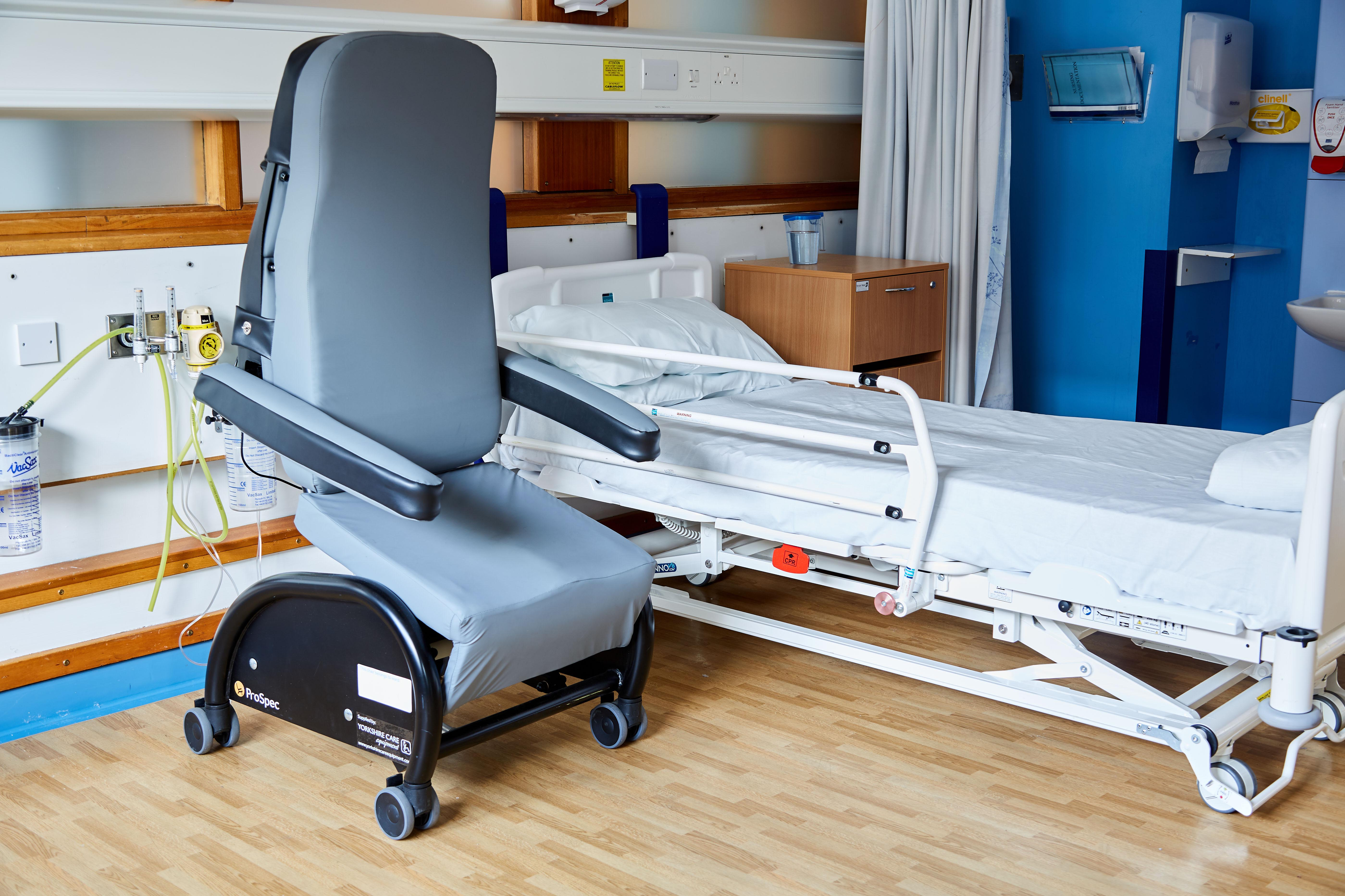 A ProSpec hospital chair in raised position to help the patient to a standing position.